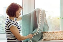 Interior designer shows samples of fabrics and accessories for c Stock Photo