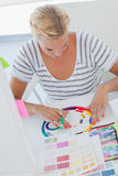 Interior designer working on a colour wheel Stock Photo