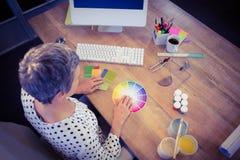 Interior designer working at desk Royalty Free Stock Photos