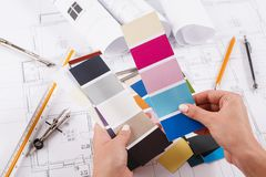 Interior designer working with palette closeup. Interior designer working with color palette closeup. Architect choosing colors for building decoration, copy stock image