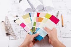 Interior designer working with palette closeup. Interior designer working with color palette closeup. Architect choosing colors for building decoration, copy stock photo
