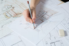 Hand drawing details of the interior. Interior designer works on a hand drawing sketch using color pencils, rule and rubber royalty free stock photo