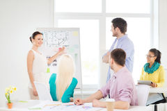 Interior designers having meeting in office. Education, interior design and office concept - smiling interior designers having meeting in office Royalty Free Stock Photos