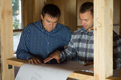 Interior Designers Talk About Blueprint Design Royalty Free Stock Photo