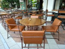 Interior desingn of a cafe restaurant, brown tables and chairs royalty free stock photo