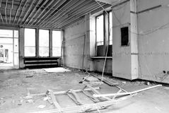 The interior of a devastated building. Black and white. Corridor in the destroyed building, no Windows and no doors royalty free stock image
