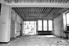 The interior of a devastated building. Black and white. Corridor in the destroyed building, no Windows and no doors stock photography