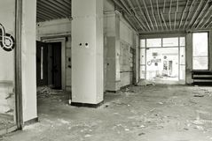 The interior of a devastated building. Black and white. Corridor in the destroyed building, no Windows and no doors stock image