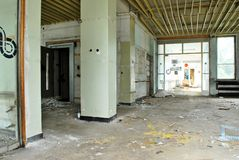 The interior of a devastated building. Corridor in the destroyed building, no Windows and no doors stock image