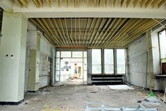 The interior of a devastated building. Corridor in the destroyed building, no Windows and no doors royalty free stock photo
