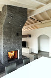 Interior, dining table and fireplace Royalty Free Stock Image