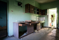 Interior of a dirty abandoned cuisine room Stock Photography