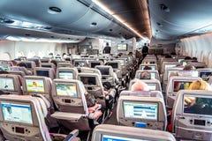 Interior do avião com passageiros Imagens de Stock