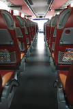 Interior do barramento grande do ônibus com assentos de couro Imagem de Stock Royalty Free