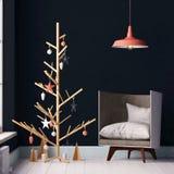 Interior do modelo com árvore de Natal e poltrona Fotos de Stock