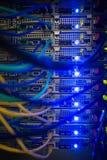 Interior do servidor com os fios azuis Fotografia de Stock Royalty Free