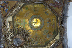 Interior dome of old basilica in Mexico City. Beautiful intricate design and painting of interior dome of old basilica of Guadalupe cathedral in Mexico City Stock Photo