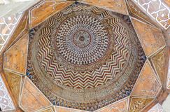 The interior of the dome. The unique geometrical mosaic art in the mosque of the Samarkand stock images