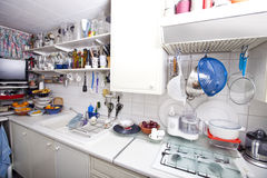 Interior of domestic kitchen with utensils and shelves Royalty Free Stock Images
