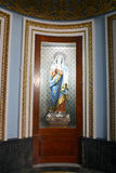 Interior door at the Parish Church of Santa Maria in Mosta, Malta. Mosta, Malta – January 28, 2016. Interior door with a religious painting at the Parish Stock Image