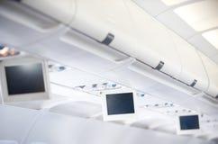 Interior dos aviões comerciais Fotos de Stock Royalty Free