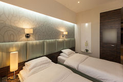 Interior of a double hotel bedroom in the evening Stock Image