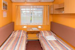 Interior of the double living cabin on a cruise ship. With beds and window Stock Photos