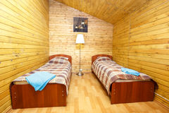 Interior of double room with separate beds. And standard lamp stock images