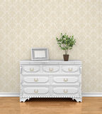 Interior with dresser near empty blue wall. Royalty Free Stock Images