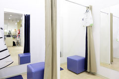 Interior of dressing room at cloth store Stock Photos