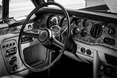 Interior of the driver's seat of the car Rolls-Royce Corniche I Cabriolet. BERLIN, GERMANY - MAY 17, 2014: Interior of the driver's seat of the car Rolls-Royce Royalty Free Stock Photos