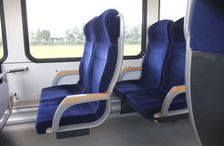 Interior of a Dutch train with blue seats Stock Photos
