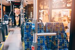 Interior e assentos modernos do ônibus da cidade Fotografia de Stock