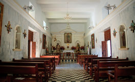 Interior of El Quelite Church in Mexico. Interior shot down the aisle of the El Quelite Church in Mexico royalty free stock photography