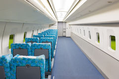 Interior of electric train with empty seats business transportat Royalty Free Stock Photo
