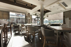 Interior of an elegant riverside cafe Stock Photography