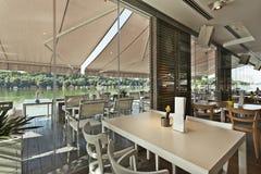 Interior of an elegant riverside cafe Royalty Free Stock Photo