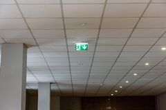 Interior elements in large hall. exit sign. Interior elements in large hall. green exit sign on the sealing Stock Image