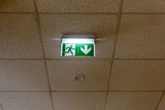 Interior elements in large hall. exit sign. Interior elements in large hall. green exit sign on the sealing Stock Images