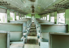 Interior of an empty antiqued train cabin in Thailand. Stock Photos