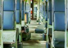 Interior of an empty antiqued train cabin in Thailand. Stock Images