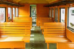 Interior of an empty antiqued train cabin in Thailand. Royalty Free Stock Image