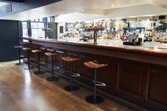 Interior Of Empty Bar With Stools And Counter stock photo