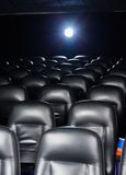 Interior Of Empty Cinema Theater. With projector light Royalty Free Stock Images