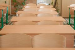 Interior of empty classroom with chairs and desks in a row.  royalty free stock photos