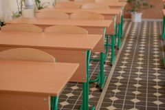 Interior of empty classroom with chairs and desks in a row.  royalty free stock photo