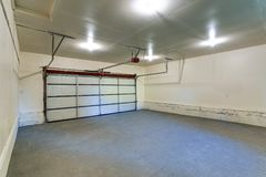 Interior of an empty clean garage with closed door Stock Images