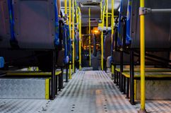 Interior of an empty collective bus at night seen from the bottom chairs. View from floor Royalty Free Stock Photos