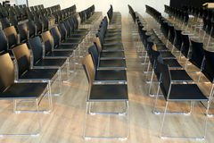 Interior of empty conference hall with gray colored chairs Royalty Free Stock Photography