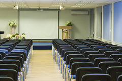 Interior of Empty Conference Hall With Lines of Blue Chairs in F Royalty Free Stock Image